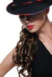 Ritratto della donna elegante con il cappello nero Fotografia Stock
