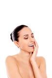 Ritratto della donna nuda sorridente isolata su fondo bianco Fotografia Stock