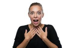 Ritratto della donna sorpresa su fondo bianco Fotografia Stock
