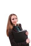 Ritratto della donna sorridente di affari con la cartella di carta, o isolata Immagine Stock
