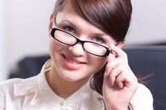 Ritratto della donna in vetri Fotografia Stock