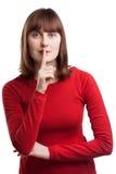 Ritratto della femmina attraente che mostra segno silenzioso Fotografia Stock Libera da Diritti