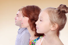 Ritratto della figlia del papà e della mamma nel profilo Fotografie Stock Libere da Diritti