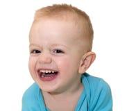 Ritratto della fine di risata del bambino su È isolato su un bianco Fotografia Stock Libera da Diritti