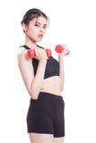 Ritratto della giovane donna che fa esercizio fotografia stock libera da diritti