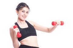 Ritratto della giovane donna che fa esercizio Immagini Stock