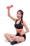 Ritratto della giovane donna che fa esercizio Fotografia Stock