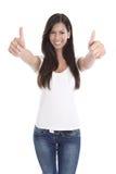 Ritratto della giovane donna con i pollici su Fotografia Stock