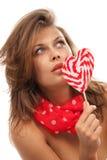 Ritratto della giovane donna con la lecca-lecca fotografia stock libera da diritti