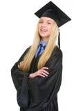 Ritratto della giovane donna felice in abito di graduazione Fotografie Stock Libere da Diritti