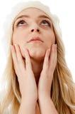 Ritratto della holding della donna il suo fronte ed osservare in su Immagine Stock Libera da Diritti