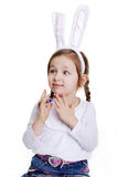 Ritratto della neonata con le orecchie del coniglietto Immagini Stock