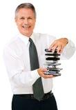 Ritratto della pila della holding dell'uomo d'affari di telefoni Immagini Stock