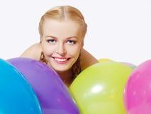Ritratto della ragazza allegra con gli aerostati Fotografia Stock