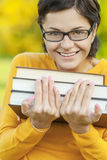 Ritratto della ragazza con i libri Fotografie Stock Libere da Diritti