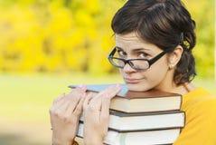 Ritratto della ragazza con i libri Fotografie Stock