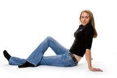 Ritratto della ragazza di seduta Fotografie Stock Libere da Diritti
