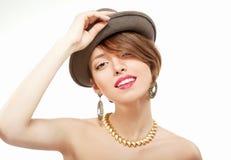 Ritratto della ragazza sorridente in cappello Fotografia Stock
