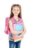 Ritratto della scolara sorridente con i libri e lo zaino Fotografia Stock Libera da Diritti