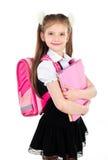 Ritratto della scolara sorridente in uniforme con lo zaino Fotografie Stock