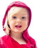 Ritratto della spiaggia isolata di un bambino sveglio nel colore rosso Fotografia Stock