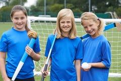 Ritratto della squadra di hockey della ragazza immagine stock