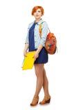 Ritratto della studentessa diligente con le cartelle e il univ dello zaino Immagini Stock Libere da Diritti