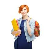 Ritratto della studentessa diligente con le cartelle e il univ dello zaino Fotografie Stock Libere da Diritti