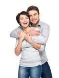 Ritratto delle coppie felici isolate su bianco Fotografie Stock