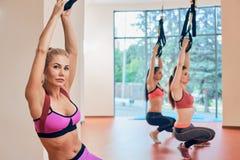 Ritratto delle donne di forma fisica TRX tre Fotografie Stock Libere da Diritti