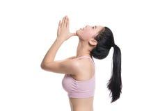 Ritratto dello studio della donna asiatica di anni venti che fa yoga Immagine Stock