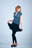 Ritratto dello studio della ragazza di posizione Fotografie Stock