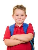 Ritratto dello zaino d'uso dello studente felice della scuola elementare Immagine Stock