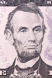 Ritratto di Abraham Lincoln su cinque U S Banconota in dollari fotografia stock libera da diritti