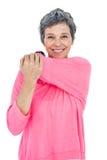 Ritratto di allungamento maturo felice della donna Fotografia Stock