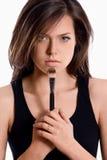 Ritratto di bella donna che applica cosmetico. Trucco Immagine Stock Libera da Diritti