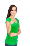 Ritratto di bella giovane donna di successo che dà i pollici su Fotografia Stock