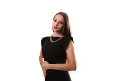 Ritratto di bella ragazza in un poco vestito nero isolato sopra Immagini Stock Libere da Diritti