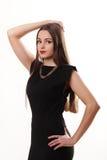 Ritratto di bello fronte di una giovane donna con il hai marrone lungo Fotografia Stock