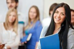 Ritratto di bello studente sorridente con i libri Fotografie Stock