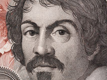 Ritratto di Caravaggio su 100000 Lire italiane della banconota di macr del primo piano Fotografie Stock Libere da Diritti