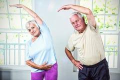 Ritratto di esercitazione della donna e dell'uomo senior Immagine Stock Libera da Diritti