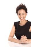 Ritratto di giovane bella donna di affari in un iso nero del vestito Fotografie Stock