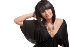 Ritratto di giovane brunette sorridente in un Dott. nero Fotografie Stock