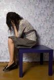 Ritratto di giovane donna che sembra deprimente fotografia stock libera da diritti