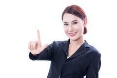 Ritratto di giovane donna di affari che indica su Immagini Stock