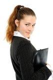 Ritratto di giovane donna di affari con un dispositivo di piegatura fotografie stock