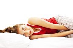 Ritratto di giovane donna in pigiami che risiedono nella base Fotografia Stock Libera da Diritti
