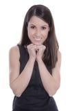 Ritratto di giovane donna sorridente in vestito nero isolato. Fotografia Stock