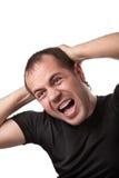 Ritratto di giovane uomo arrabbiato che sreaming Immagine Stock